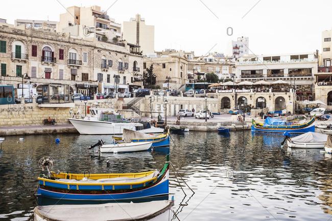 Boats in harbor along seaside village