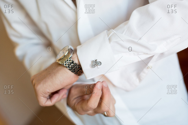Man putting on bicycle cuff links