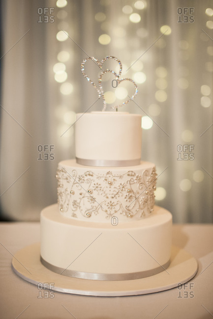 Three-tiered wedding cake with silver decorations