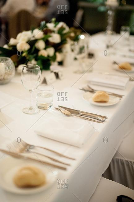 Simple white elegant wedding place settings