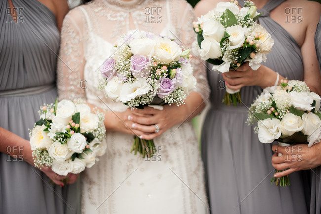 Bride and four bridesmaids holding bouquets