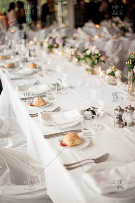 Long banquet table set for a wedding reception