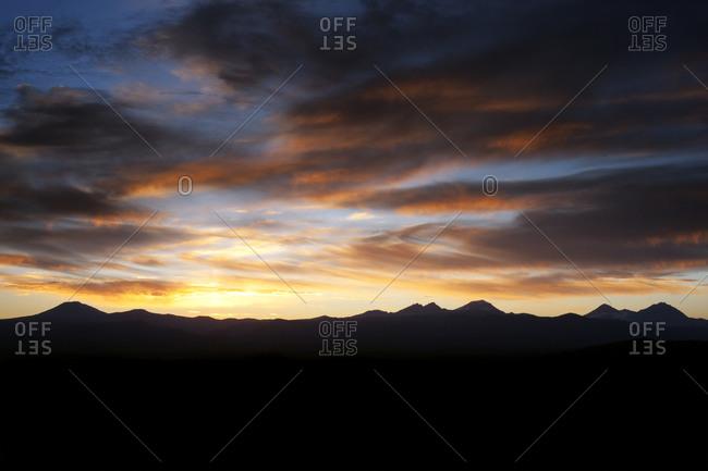 Skies at sunset over mountain range