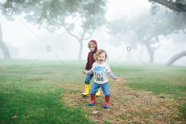 Little boy dancing with brother in the park