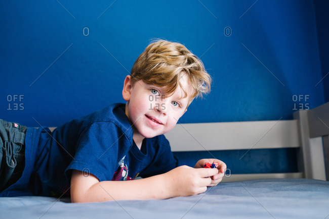 Boy posed with blue wall