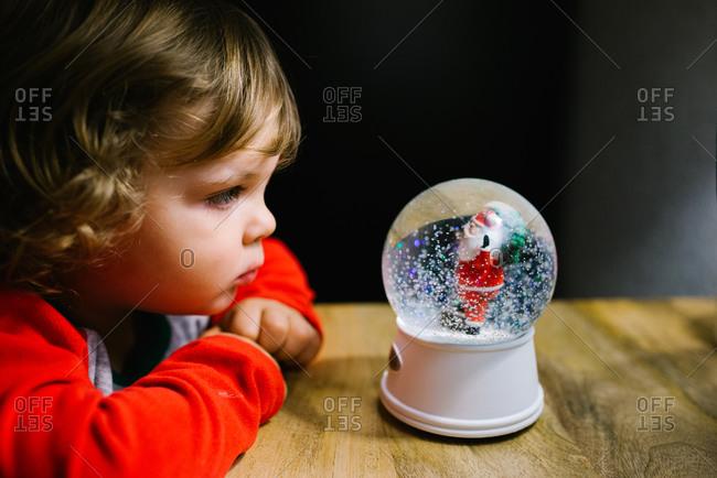Boy looking at snow globe