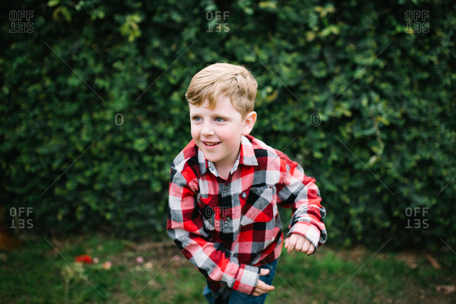 Boy pretending to throw ball