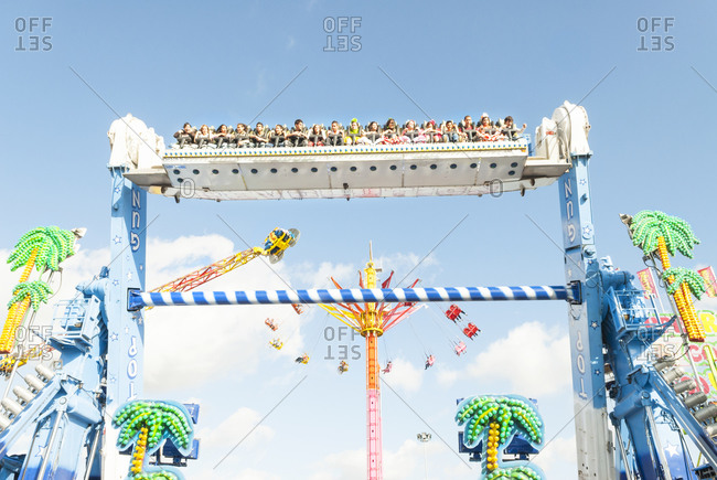 Jerez, Spain - May 12, 2009: Children enjoying a thrilling ride at a carnival in Spain