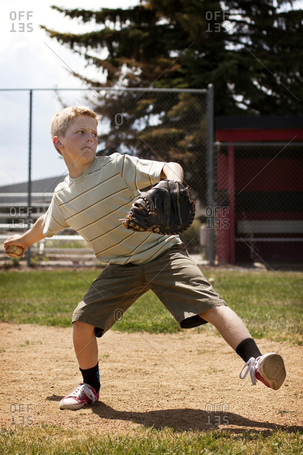 Boy in middle of baseball pitch