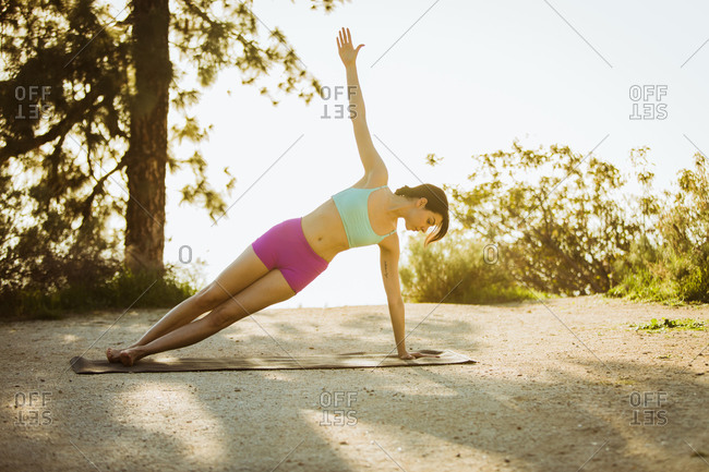 Brunette woman practicing yoga