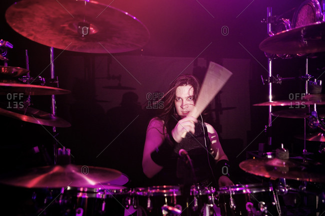 A drummer in a 1980s cover band