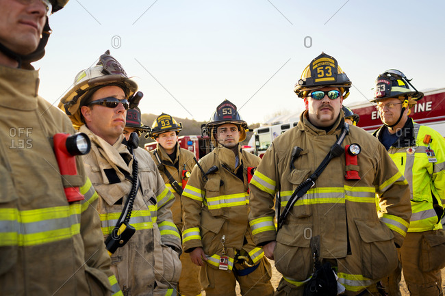 Firefighters gather around for a training