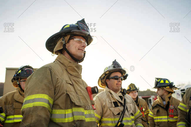 Firemen gather around for a training