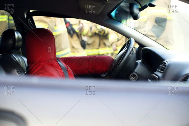 A rescue dummy in a car