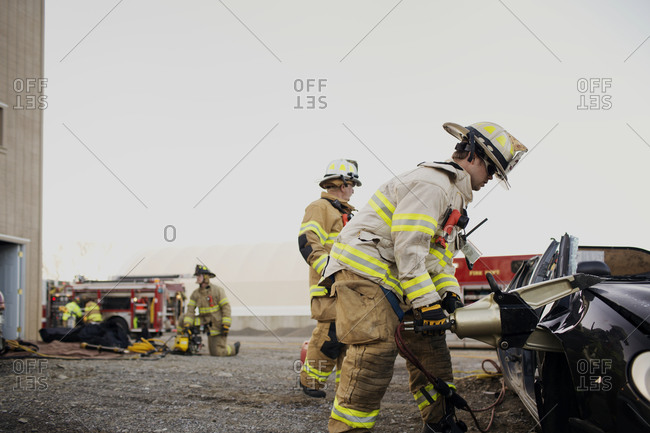 Firefighters using the jaws of life to break into a car