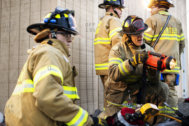 Firefighters work together during a training session