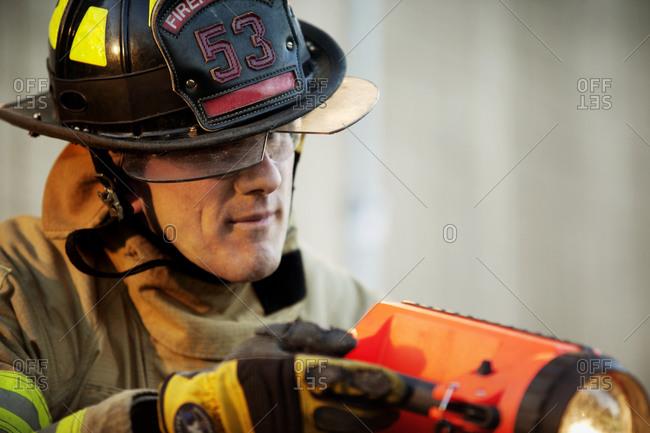 A fireman using a flashlight