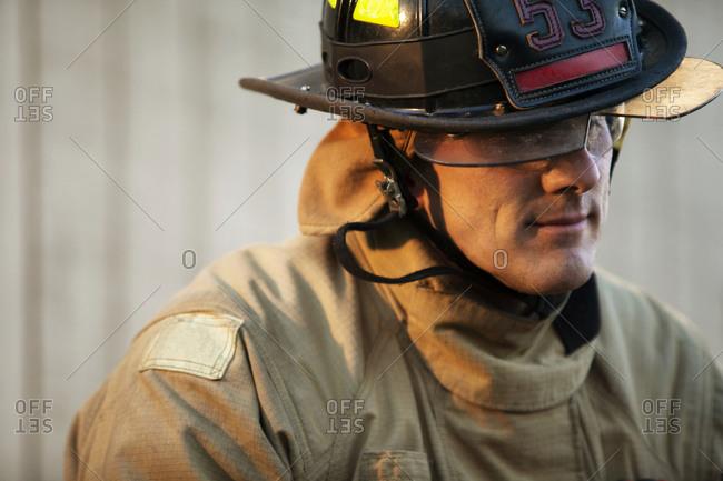 A fireman wearing his helmet