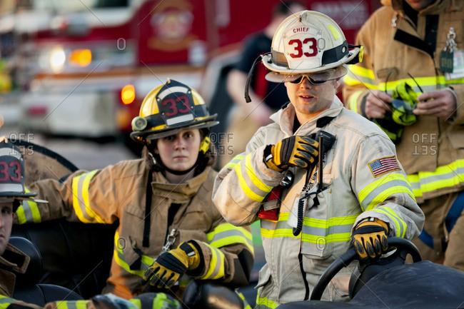 A fire chief talking into a walkie talkie
