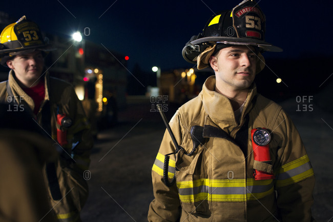 Firefighters gathering at night