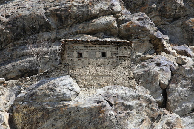 A mud and brick house built on rock