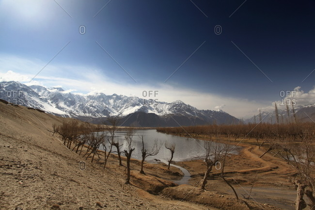 A small lake at the base of a mountain range in Pakistan
