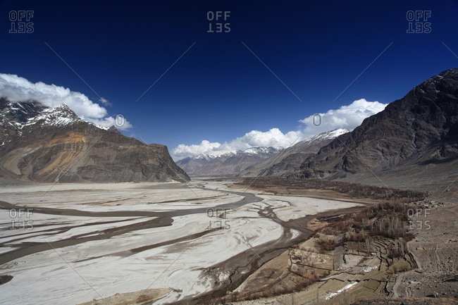 A dried riverbed in a mountain valley