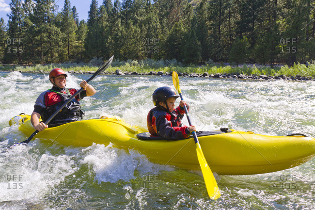 Father and son kayaking in Idaho