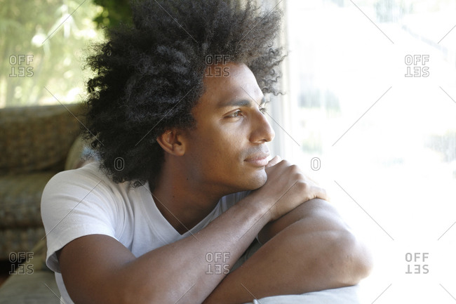 Young man looking out the window
