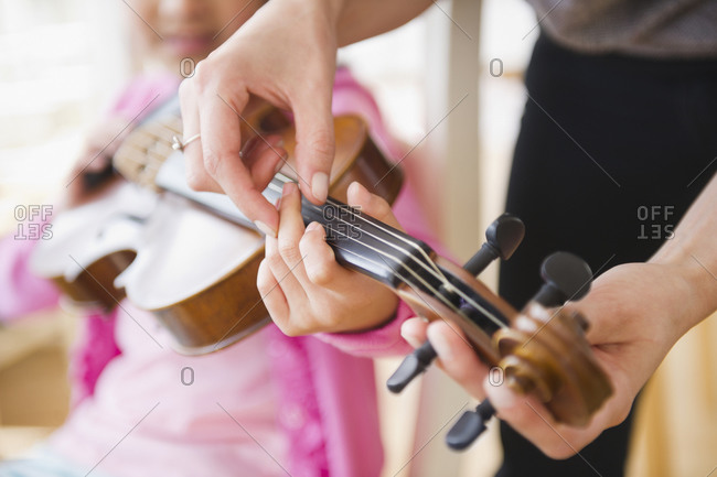 Little girl learning to play the violin