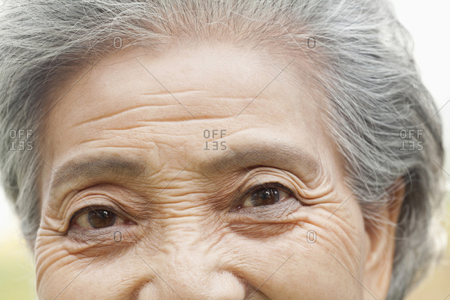 Wrinkles around a woman's eyes