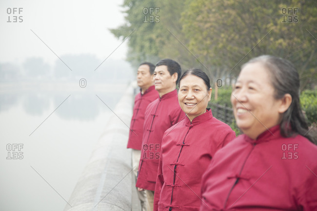 People in red uniforms at Jingshan Park, Beijing, China