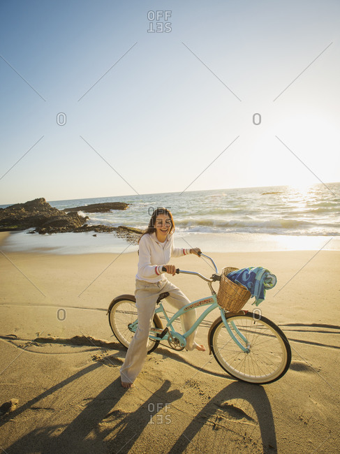 Woman riding a bicycle on beach