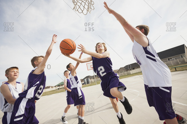Group of children playing basketball