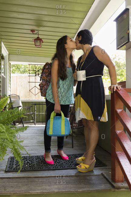 Girl saying goodbye to her mother