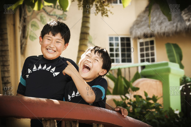 Brothers laughing together outdoors