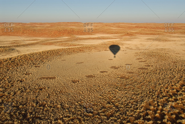Shadow of hot-air balloon above the Namib Desert, Namibia, Africa