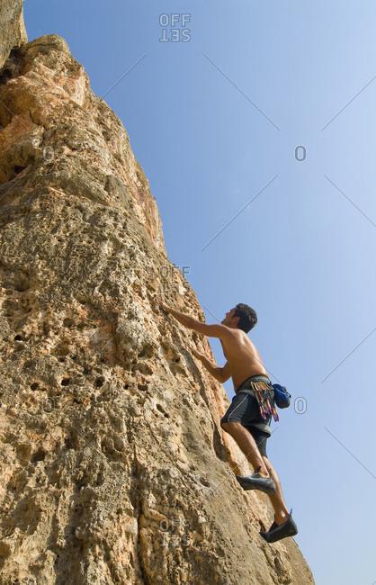 Man climbing up a rock wall
