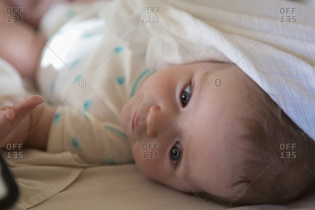 Close up of baby lying in bed