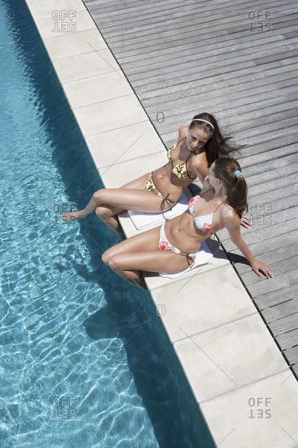 High angle view of women relaxing by swimming pool