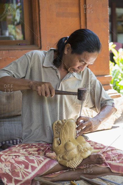 Artist working on a dragon sculpture