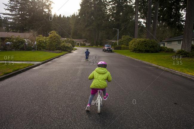 Children riding bicycles on suburban street