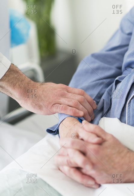 Doctor reassuring patient in hospital