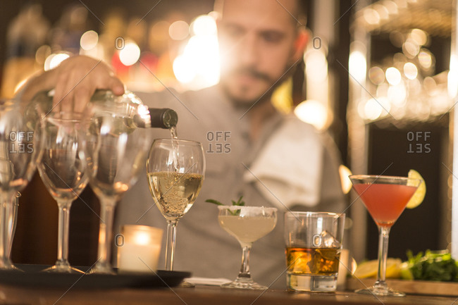 Bartender pouring drinks in a bar