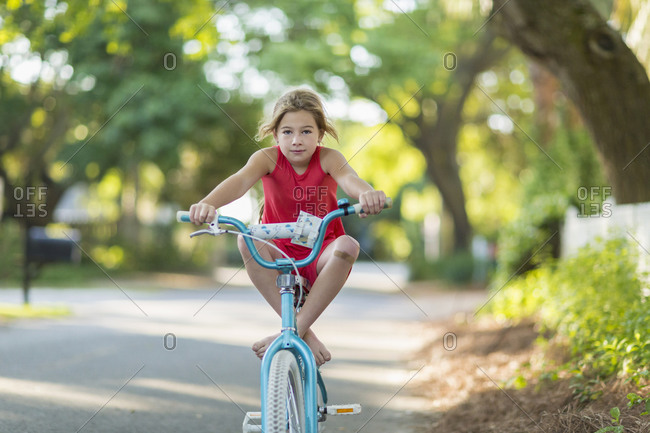 Young girl riding a bicycle on street