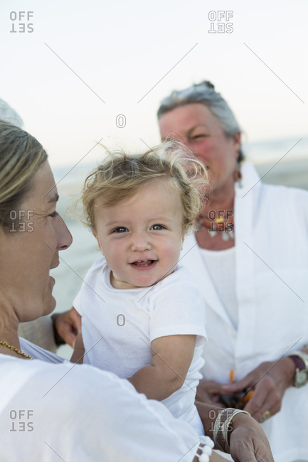 Woman holding a baby on a beach