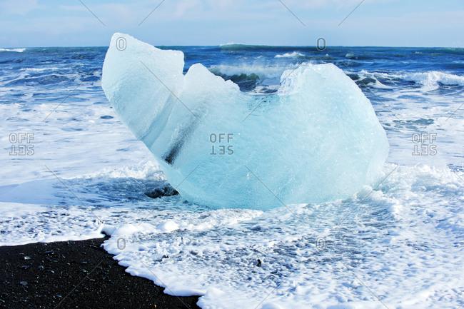 Ice chunk melting on a coast