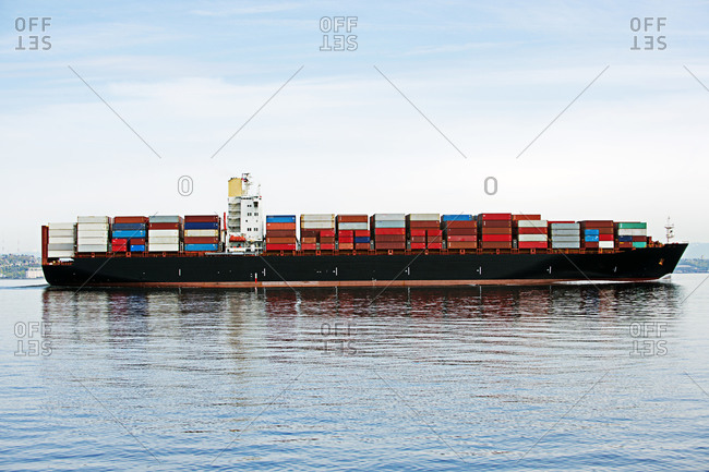 Cargo ship sailing in a bay