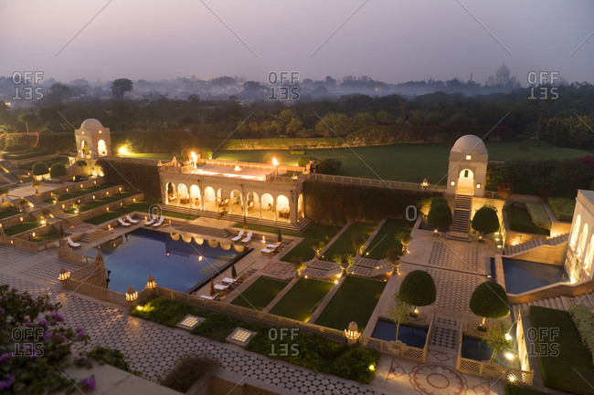 Taj Mahal gardens at dusk in Agra, India