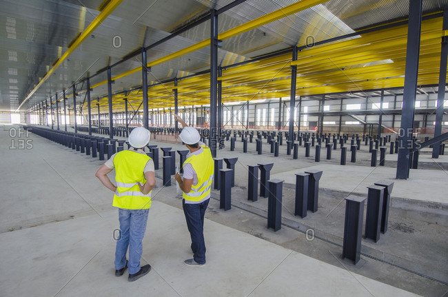 Colleagues talking in a warehouse